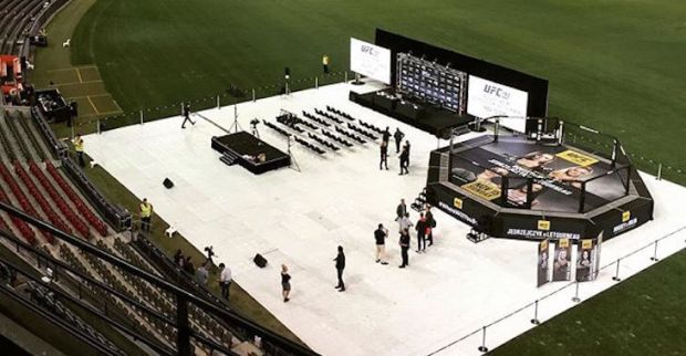 Picture courtesy of http://www.bjpenn.com/mmanews/pic-of-the-day-the-octagon-looks-tiny-in-massive-australian-stadium/